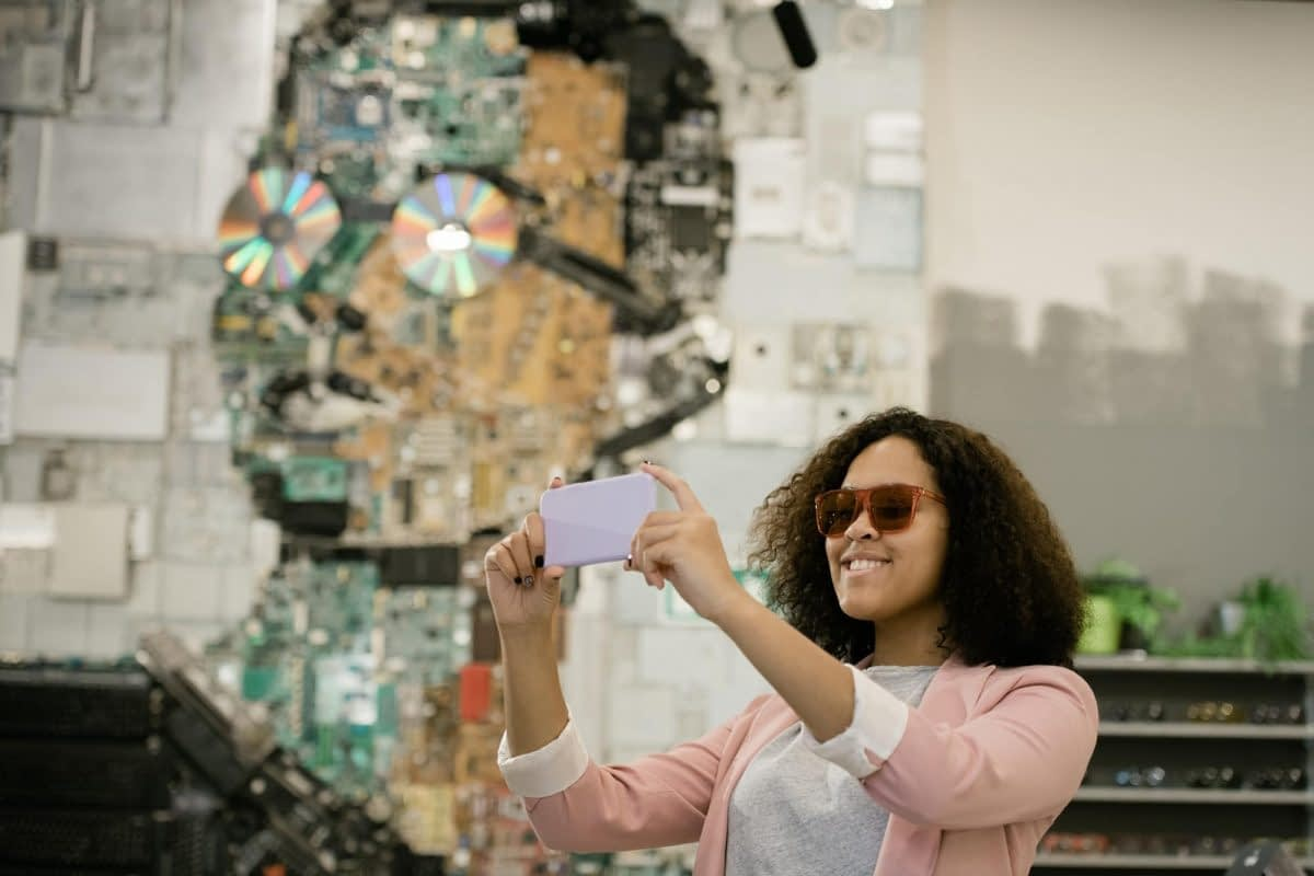 young-cheerful-female-in-sunglasses-making-selfie-in-contemporary-optics-shop.jpg